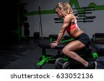 woman leaning on bench in gym | Shutterstock . vector #633052136