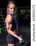 woman doing bicep curl | Shutterstock . vector #633052172