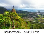 woman standing on the peak of a ... | Shutterstock . vector #633114245