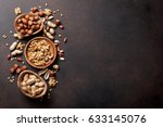 various nuts on stone table.... | Shutterstock . vector #633145076