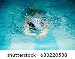 boy in a freestyle swim race | Shutterstock . vector #633220538
