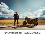 biker with motorcycle stands on ... | Shutterstock . vector #633229652