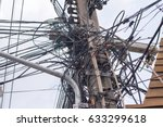 mess of wire and cable clutter... | Shutterstock . vector #633299618