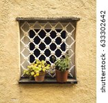 small window with flowers in...   Shutterstock . vector #633302642
