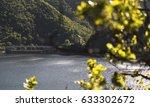 lake landscape behind tree...   Shutterstock . vector #633302672