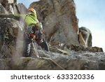climber climbs up the cliffs... | Shutterstock . vector #633320336