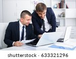 two smiling male business... | Shutterstock . vector #633321296