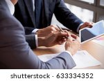 close up of businessmen using... | Shutterstock . vector #633334352