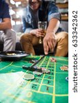 young men playing roulette game.... | Shutterstock . vector #633342362