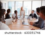 businesswoman stands to address ... | Shutterstock . vector #633351746
