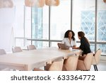 two businesswomen using laptop... | Shutterstock . vector #633364772