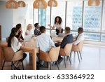 businesswoman stands to address ... | Shutterstock . vector #633364922