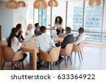 businesswoman stands to address ... | Shutterstock . vector #633364922