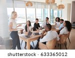 businesswoman leads meeting... | Shutterstock . vector #633365012