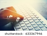 closeup of person hand typing... | Shutterstock . vector #633367946