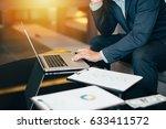 handsome businessman in suit... | Shutterstock . vector #633411572