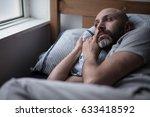 mid forties depressed man in... | Shutterstock . vector #633418592