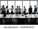 businesspeople stand and chat... | Shutterstock . vector #633424205