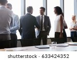 businesspeople shaking hands... | Shutterstock . vector #633424352