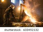 worker controlling metal... | Shutterstock . vector #633452132