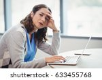 portrait tired executive using... | Shutterstock . vector #633455768