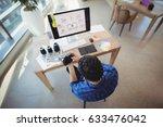 overhead of graphic designer... | Shutterstock . vector #633476042