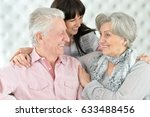 happy parents with an adult... | Shutterstock . vector #633488456