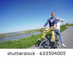 cheerful couple riding bike on... | Shutterstock . vector #633504005