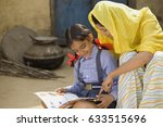 rural mother reading with her... | Shutterstock . vector #633515696