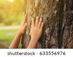 children's hug big tree ... | Shutterstock . vector #633556976