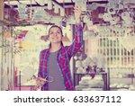 woman in shop of home... | Shutterstock . vector #633637112