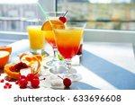 glasses of tequila sunrise... | Shutterstock . vector #633696608