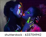 fashion models kissing in uv... | Shutterstock . vector #633704942