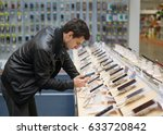 young male customer choosing... | Shutterstock . vector #633720842