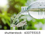 drinking water poured into the... | Shutterstock . vector #633755315