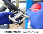 lubricating the pedal in the... | Shutterstock . vector #633914912