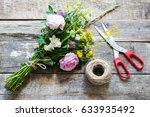 bunch flowers on a wooden...   Shutterstock . vector #633935492