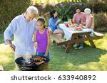 grandfather and granddaughter... | Shutterstock . vector #633940892