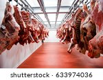 a lot of half cow chunks fresh... | Shutterstock . vector #633974036