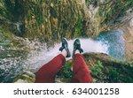 male traveler sitting on cliff... | Shutterstock . vector #634001258