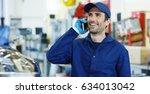 assistant mechanic calls... | Shutterstock . vector #634013042