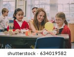 primary school teacher is... | Shutterstock . vector #634019582