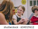 primary school students are... | Shutterstock . vector #634019612