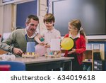 primary school teacher is... | Shutterstock . vector #634019618