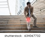 businessman suffering from knee
