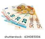 euro banknotes and euro coins  | Shutterstock . vector #634085006