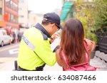 asian woman tourist asking... | Shutterstock . vector #634087466