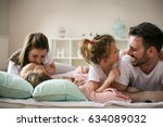 cheerful family playing... | Shutterstock . vector #634089032