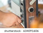 hand tuning fm radio button.... | Shutterstock . vector #634091606