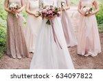 bride and bridesmaid are... | Shutterstock . vector #634097822